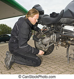 Checking a motorcycle - A motorist having problems and...