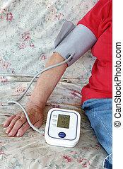 checking blood pressure - elderly woman self checking her ...