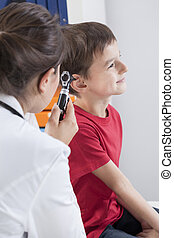 Checking by otoscope