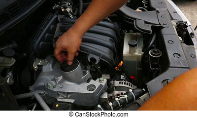 Checking car engine fluid - 	Checking car engine fluid