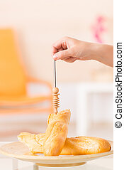 Checking food with pendulum - Hand with pendulum dowsing...