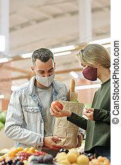 Checking fruit before buying