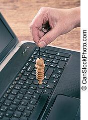 Checking laptop with pendulum - Hand with pendulum dowsing...