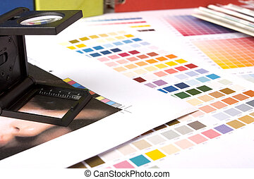 checking printing with a lupe - typical graphic designers...