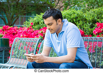 Checking smart phone - Closeup portrait, young happy man in...