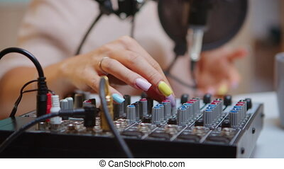 Content creator checking sound on dj mixer for better podcast. Creative online show presenter, On-air online production internet broadcast show host streaming live content, recording digital media