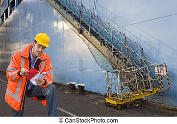 Checking the boardinglist - A man, wearing a reflective...