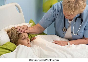 Checking the temperature - Elderly female pediatricians...