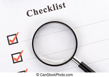 Checklist and magnifier close up
