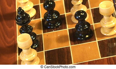 Checkmate - Finger putting down the king in check on the...