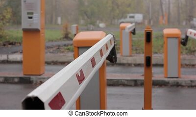 checkpoint three posts. Automatic road barrier gate lifting...