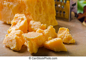 Cheddar Cheese - A grouping of crumbled cheddar cheese.