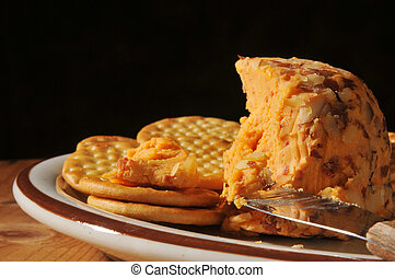 Cheddar cheese and crackers - A cheddar cheese ball with...