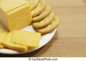 Cheddar Cheese and Crackers on Plate - Yellow cheddar cheese...