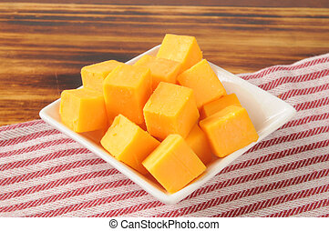 Cheddar cheese cubes - A small dish of cheddar cheese cubes...