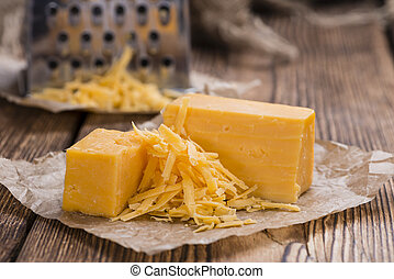 Cheddar Cheese (grated) as close-up shot on an old vintage...
