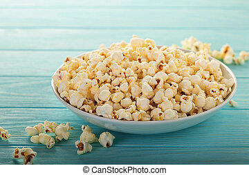 Cheddar cheese popcorn in a white bowl