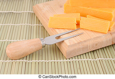 cheddar cheese - blocks of cheddar cheese on a wooden block...