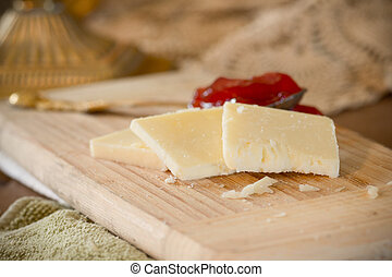 Cheddar Cheese - White cheddar cheese slices on cutting...