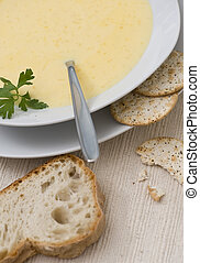 Cheddar Soup - A fresh bowl of hot cheddar soup with bread...