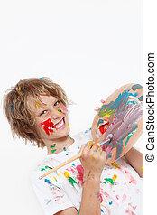 cheeky, criança, tocando, com, pintura