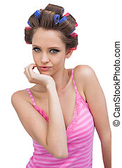 Cheeky model posing wearing hair curlers