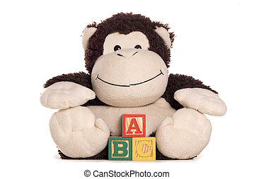 Cheeky monkey soft toy with abc alphabet blocks