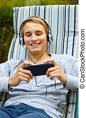 Youth playing on game console