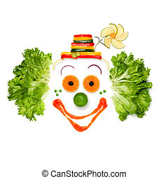 A portrait of joyful clown made of vegetables and sauce.