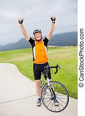cheerful active senior man arms up