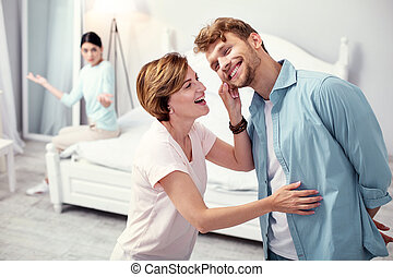 Cheerful adult man being with his mother
