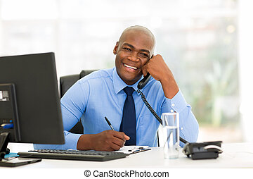 african american businessman talking on phone in the office