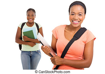 african american college student holding laptop
