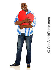 african american man hugging a red heart shape