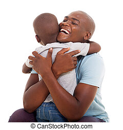 african american man hugging his son