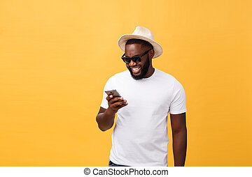 Cheerful African American man in white shirt using mobile ...