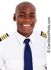 african american pilot in uniform - cheerful african...