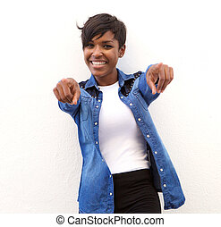 Cheerful african american woman pointing fingers