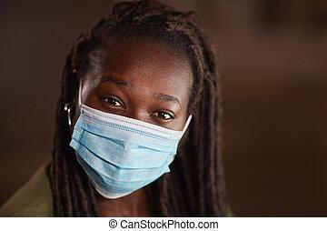 Cheerful African-American Woman Wearing Mask