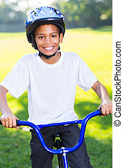 african boy riding a bicycle