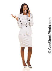 african business executive making a phone call