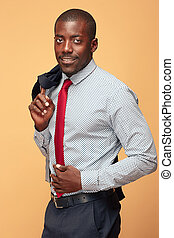 cheerful african businessman looking at the camera