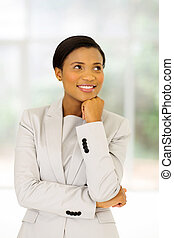 african businesswoman looking up in office
