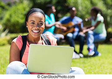 african college student using laptop