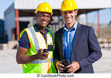 african construction worker and manager