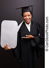 african female graduate with blank text bubble