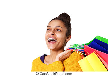 Cheerful african girl with shopping bags