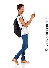 african university student using smart phone