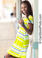 african woman in shopping center