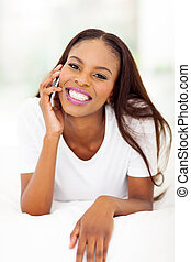african woman making phone call